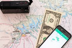 Travel accessories, camera, smart phone one Dollar bill and travel map, detail of Arizona, USA map. Travel preparation and planning concept to Lake Powell area royalty free stock photo