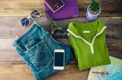 Travel accessories and costume on wooden floor for trip. Royalty Free Stock Photos