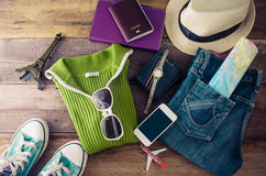 Travel accessories and costume on wooden floor for trip. Stock Photography