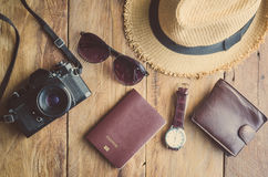 Travel accessories costumes The cost of travel. Travel accessories costumes. Passports, luggage, The cost of travel maps prepared for the trip Royalty Free Stock Photo