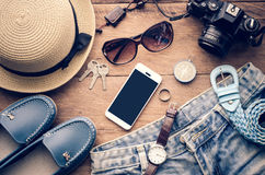 Travel accessories costumes The cost of travel. Travel accessories costumes. smart phone, luggage, The cost of travel prepared for the trip Stock Photography
