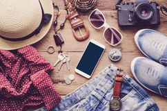 Travel accessories costumes The cost of travel. Travel accessories costumes. smart phone, luggage, The cost of travel prepared for the trip Stock Images