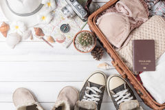 Travel accessories costumes on white wood background Stock Image