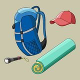 Travel accessories for a hike on a gray background. royalty free illustration