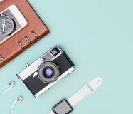Travel accessories objects gadgets top view flatlay on blue pastel. Travel accessories objects and gadgets top view flatlay on blue pastel stock photography