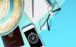 Travel accessories objects gadgets top view flatlay on blue teal shade. Travel accessories objects and gadgets top view flatlay on blue teal shade royalty free stock photo