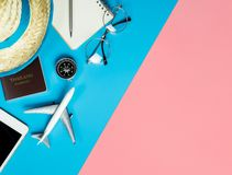 Travel objects and gadgets top view flatlay on blue yellow pink. Travel accessories objects and gadgets top view flatlay on blue yellow pink royalty free stock image