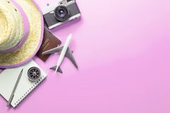 Travel accessories objects gadgets top view flatlay on pink pastel royalty free stock image