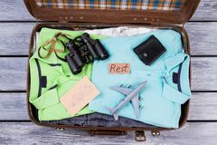 Travel accessories in opened suitcase. Flat lay, top view. Packed luggage Stock Photography