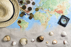Travel accessories over world map Royalty Free Stock Photo