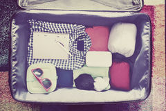 Travel accessories in a suitcase. Vintage toned Stock Photography