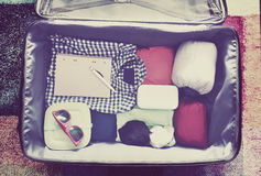 Travel accessories in a suitcase. Vintage toned Stock Photos