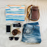 Travel accessories. Sweaters, jeans, cellphone, belts, wallets, Stock Images