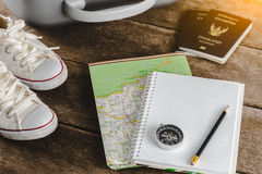 Travel accessories for the travel trip. Passports. Luggage, compass, notebook, pencil The cost of travel maps prepared for the adventure travel trip royalty free stock photography