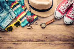 Travel accessories on wooden floor ready for travel. Royalty Free Stock Photo