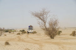 Travel across Africa. African off road terrain. Dust cloud. Royalty Free Stock Images