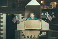 Travel and adventure. Small boy play in paper rocket, childhood. Earth day concept. Dream about career of cosmonaut. Happy independence day of the usa royalty free stock photos