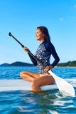 Travel Adventure. Woman Paddling On Surfing Board. Recreation, W Stock Photography