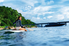 Travel Adventure. Woman Paddling On Surfing Board. Recreation, W Stock Image
