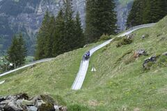 Free Travel Adventures- Adult And Kid Ride A Luge Down Hill. Royalty Free Stock Photos - 187253878