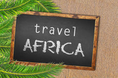 Travel Africa palm trees and blackboard on sandy beach. Close Royalty Free Stock Photo