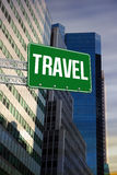Travel against low angle view of skyscrapers Royalty Free Stock Photo