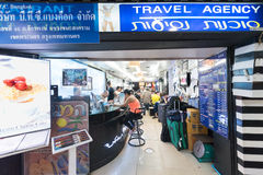 Travel agency in Bangkok. BANGKOK - MARCH 9, 2015: Unidentified tourists sit at a travel agency in Sam Sen Road (near Khao San) waiting for transport to their Royalty Free Stock Photography