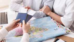 Travel agency. Couple getting passports and tickets. Closeup stock images