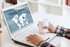 Travel agency. Hands looking for agency of trips online, travel agency Royalty Free Stock Images