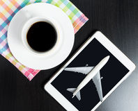 Travel agency Internet booking on Tablet in a coffee shop. Royalty Free Stock Images