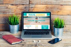 Travel agency website in a laptop screen. Escape concept. On line travel agency website template design in a device screen stock image