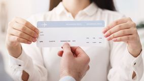 Travel agency. Woman showing flight ticket to customer. Closeup royalty free stock photos