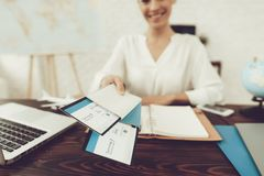 Travel Agent Holding Tickets in Travel Agency. Smiling Woman in Office. Consultant in Travel Office. Airplane Tickets. Modern Office. Holding Tickets in Hand stock images
