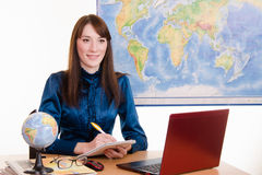 Travel agent listens to customer needs Royalty Free Stock Photo