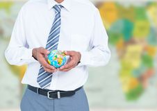 Travel agent mid section holding globe against blurry map Stock Photos