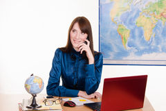 Travel agent talking on the phone Stock Photography