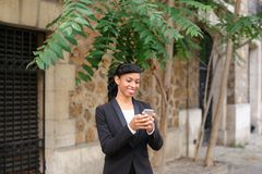 Travel administrator advising tours on smartphone in park. Travel agent talking on smartphone with client and advising cheap tours in park. Pretty female person Royalty Free Stock Photo