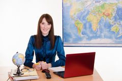 Travel agent waits for customers Stock Images