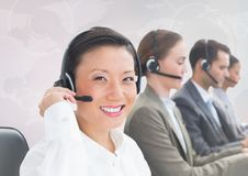 Travel agents with headsets against white map Royalty Free Stock Image