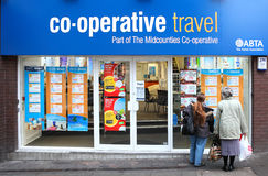 Travel agents shop front. Co operative travel is an ABTA and ATOL approved UK agents, store front with people browsing holidays / vacations. Wolverhampton High stock photos