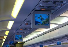 Travel on Airplane. View of Map of Europe on the inflight screens in an airplane cabin royalty free stock images