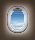 Travel by airplane concept. Airplane interior or jet window. With clouds and sky Royalty Free Stock Image