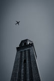 Travel - airplane over tower Royalty Free Stock Photo