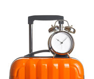Alarm clock on orange suitcase Royalty Free Stock Images