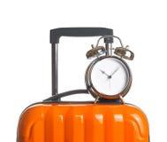 Alarm clock on orange suitcase Royalty Free Stock Images
