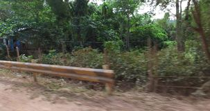 Travel along the roads near the village of tricycle. BUKANA, PHILIPPINES - FEB. 1:Travel along the roads near the village of tricycle FEB. 1, 2016 in Bucana stock footage