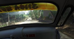 Travel along the roads near the village of tricycle. BUKANA, PHILIPPINES - FEB. 1:Travel along the roads near the village of tricycle FEB. 1, 2016 in Bucana stock video footage