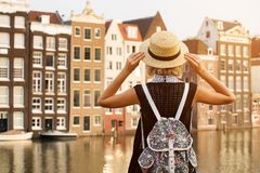 Travel in Amsterdam. Beautiful woman on vacation in Amsterdam city royalty free stock photography