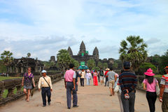 Travel in Angkor Wat. ANGKOR WAT, SIEMPEAP, KHMER REPUBLIC - NOVEMBER 6 : The unidentified people are travelling in Angkor Wat, one of the world heritages on stock image