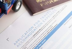 Travel application form and passport. On the table royalty free stock image